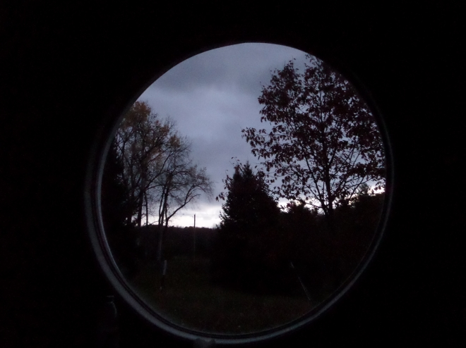 Midnight blue pales to day: dawn through the Welcoming House meditation room window.